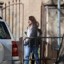 Milla Jovovich – Arriving on set of their new film in Barcelona - 454 x 557