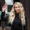 Amber Heard – All in black at the Royal Courts of Justice in London