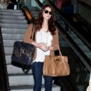 Ashley Greene arrives at LAX (Los Angeles International Airport) with a puppy in her handbag