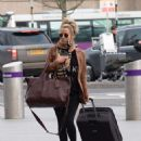 Caroline Flack flees the UK - 454 x 597