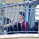 Austin Butler works hard to memorize some lines from a script outside Vanessa Hudgens  balcony on December 30, 2013 in Los Angeles