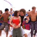 "Romantic sparks fly between Kelly (Kelly Clarkson) and Justin (Justin Guarini) as they sing and dance to ""The Bounce."" (Background dancers: Christian George, Brandon Henschel)."