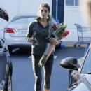 Actress Ashley Greene stops by Bristol Farms in Beverly Hills, California to buy groceries and flowers on January 15, 2015