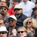 Leonardo DiCaprio and his friend Lukas Haas attend the French tennis Open round of 16 match at the Roland Garros stadium in Paris. Jo-Wilfried Tsonga of France plays against Viktor Troicki of Serbia, and Roger Federer of Switzerland over Gilles Simon of F - 454 x 286