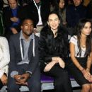 Kanye West, L'Wren Scott, Zoe and Lenny Kravitz attend the Yves Saint Laurent Fashion Show Spring/Summer 2007, on October 5, 2006 in Paris, France - 454 x 303