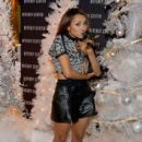 Kat Graham and her dog Izzy attend Beverly Center's Holiday Pet Portraits Debut at The Beverly Center on November 14, 2013 in Los Angeles, California