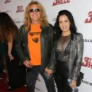 Steven Adler and Carolina arrive at the special screening of