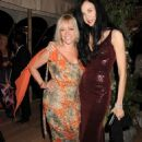 Jo Wood and L'Wren Scott attend the wedding reception of Leah Wood and Jack MacDonald at Holm Wood on June 21, 2008 in London, England - 454 x 649