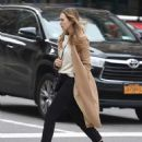 Elizabeth Olsen in a beige coat out in New York City October 16, 2017