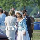 The Duchess Of York and The Princess Of Wales stand together talking at a polo match in Windsor, Berkshire with Oliver Hoare and wife Diane in background