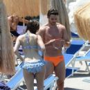 Kelly Brook showing off her bikini body in Ischia with Thom Evans (July 10)