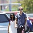 Austin Butler and Vanessa Hudgens strolled hand in hand to their car after attending a church service this morning, June 24, in Hollywood