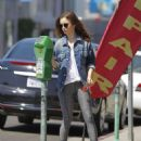 Lily Collins feeding the parking meter in Beverly Hills - 454 x 569