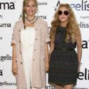 Paulina Rubio wears oversized sunglasses and poses during a press conference at the Omnilife Angelissima Tomato bar