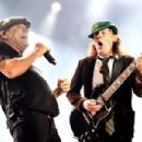 Brian Johnson and musician Angus Young of AC/DC perform at Dodger Stadium on September 28, 2015 in Los Angeles, California. - 454 x 301