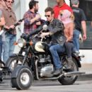 "Christina Aguilera holds onto Cam Gigandet while filming a scene atop a Triumph motorcycle for their upcoming film ""Burlesque"""