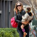Sarah Jessica Parker: comforts one of her fussy twin daughters