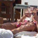 Kimberley Garner and Amy Jackson – Bikini candids at a beach in Mykonos - 454 x 296
