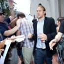 Charlie Hunnam gets mobbed by fans as he leaves the Hard Rock hotel to head to Comic Con. July 14, 2012 San Diego, California - 454 x 318