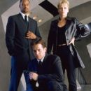 Dina Meyer as Holiday in Secret Agent Man