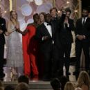 (L-R) Actors Lupita Nyong'o and Chiwetel Ejiofor, director Steve McQueen, actors Sarah Paulson and Michael Fassbender, winners of Best Motion Picture - Drama for '12 Years a Slave,' pose in the press room during the 71st Annual Golden Globe Awards held at