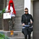Blac Chyna and Kim Kardashian Getting Their Eyebrows Done at a Private House in Beverly Hills, California - December 15, 2013