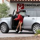 Brooke Burke – In an oversized red sweater in Malibu - 454 x 303