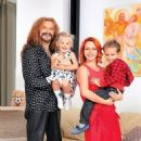 Nikita Dzhigurda and Marina Anisina with their kids