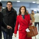 Emmy Rossum with husband Sam Esmail – Arrives at JFK Airport in NYC - 454 x 489