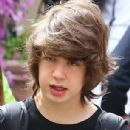 Mick Jagger's lookalike son Lucas, 17, is joined by daringly-dressed mother Luciana Gimenez as they holiday in Italy
