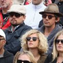 Leonardo DiCaprio and his friend Lukas Haas attend the French tennis Open round of 16 match at the Roland Garros stadium in Paris. Jo-Wilfried Tsonga of France plays against Viktor Troicki of Serbia, and Roger Federer of Switzerland over Gilles Simon of F - 454 x 311