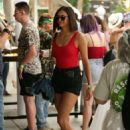 Nina Dobrev in Shorts at 2017 Coachella Music Festival in Indio