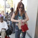 Alyson Hannigan gives a homeless man a few dollars before heading out and about in Los Angeles