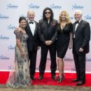 Tani Austin, George W. Bush, Gene Simmons, Shannon Tweed and Bill Austin pose at the 2015 Starkey Hearing Foundation So The World May Hear Gala at the St. Paul RiverCentre on July 26, 2015 in St. Paul, Minnesota. - 454 x 364
