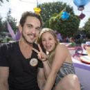 Ryan Sweeting and actress Kaley Cuoco Sweeting take a ride on The Mad Tea Party attraction at Disneyland on February 15, 2014 in Anaheim, California - 454 x 309