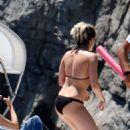 Kristen Stewart in Black Bikini on a yacht in Amalfi Coast