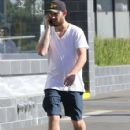 Alex Pettyfer grabs a handful of his crouch as he chats with a friend while out and about in West Hollywood, California on January 25, 2014