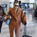 Gigi Hadid – Arriving at the airport in Milan
