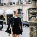 Nina Dobrev in Black Mini Dress – Out and about in Paris