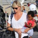 Charlize Theron- at a Cretan airport with her kids August 2016 - 454 x 481