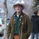 Kurt Russell enjoying a cigarette while he walks around the streets of Aspen, Colorado on December 19, 2013