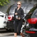 Victoria's Secret model Rosie Huntington-Whiteley shows her commitment to fitness as she starts her morning with a trip to the gym on November 12, 2014 in West Hollywood, California