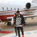 Anjali Ranadivé and Tyga Getting off a Jet Plane 12/2014