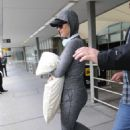 Katy Perry – Hides her baby bump as she touches down at Melbourne Airport