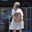 Emma Roberts – In white dress out in Los Angeles