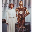 Carrie Fisher and Anthony Daniels in Star Wars: Episode IV: A New Hope (1977)