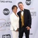 Gabrielle Carteris and Charles Isaacs At The 25th Annual Screen Actors Guild Awards 2019 - Arrivals - 413 x 600