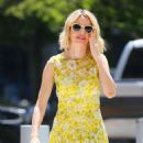 Naomi Watts in a yellow floral dress out in New York City
