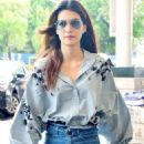 Kriti Sanon in Denim Skirt at Airport in Mumbai - 454 x 680