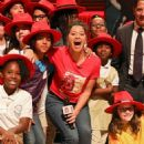 Gina Rodriguez – On stage as she hosts 'Carmen Sandiego Day' in Miami - 454 x 648